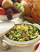 Brussels Sprouts with Slivered Almonds in a Serving Dish on Thanksgiving Table