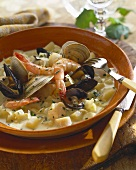 Bowl of Hearty Seafood Stew with Fork