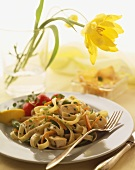 Plate of Fettuccini with Chicken, Carrots and Herbs, Flower in a Vase
