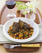 Short Ribs with Garbanzo Beans and Raisins in a White Bowl, Bamboo Fork
