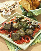 Platter of Goat Cheese Wrapped in Grape Leaves on Sliced Tomatoes