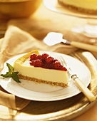 Slice of Cranberry Cheesecake on Gold Rimmed Plate, Fork