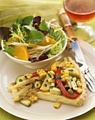 Slice of Vegetable Tart with Corn, Zucchini, Fennel and Peppers, Side Salad
