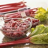 Chopped Rhubarb and Raspberries Tossed with Sugar in a Glass Bowl, Fresh Rhubarb