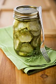Jar of Homemade Pickles with Fresh Dill and a Fork