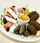 Appetizer Sampler with Dolmades, Falafel and Feta and Tomato Salad