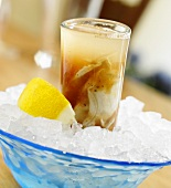 An Oyster Shooter on Ice with Lemon