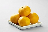 Clementines on a Square Dish