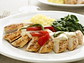 Sliced Chicken Breast in a Cream Sauce with Vegetables