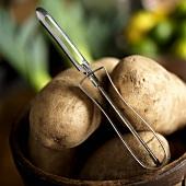 Potato Peeler on Potatoes in a Bucket