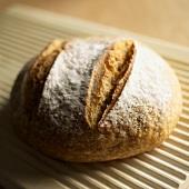 Loaf of Rustic Bread on a Bread Board