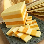 English Ilchester Cheese Partially Sliced on a Marble Board