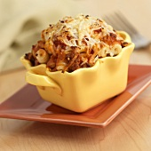 Pasta with Meat Sauce Topped with Cheese Baked in an Individual Dish