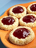 Strawberry Jam Filled Peanut Cookies on an Orange Plate