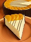 Slice of Orange Cheesecake with Chocolate Graham Cracker Crust
