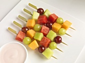 Fruit Skewers on a Plate with Raspberry Yogurt Dip