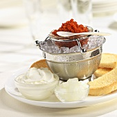 Red Caviar on Ice with Toast Points, Sour Cream and Onions