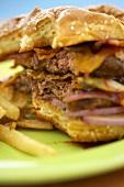Close Up of Partially Eaten Barbecue Bacon Double Cheeseburger; Fries