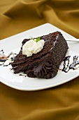 Slice of Chocolate Layer Cake with Chocolate Fudge Frosting; White Plate