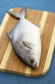 Whole Pompano Fish on a Cutting Board