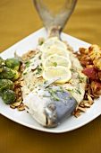 Whole Pompano Fish with Brussels Sprouts and Potatoes on a Platter