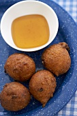 Hush Puppies with a Bowl of Honey; Fried Corn Fritters