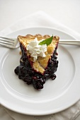 Slice of Blueberry Pie on a White Plate; Fork