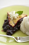 Slice of Blueberry Pie on a Green Plate with Ice Cream