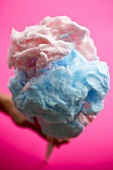Close Up of Pink and Blue Cotton Candy on a Pink background