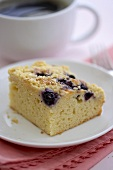 Piece of Blueberry Crumb Coffee Cake; Cup of Coffee