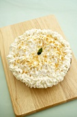 Whole Coconut Cream Pie on a Cutting Board