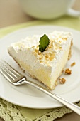 Slice of Coconut Cream Pie on a White Plate with Fork