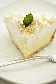 Slice of Coconut Cream Pie on a White Plate