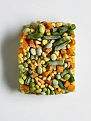 Frozen Mixed Vegetables in a Square Shape on a White Background