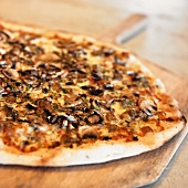 Mushroom and Sausage Pizza on a Cutting Board
