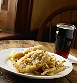 Fish and Chips with a Glass of Beer on a Wooden Pub Table