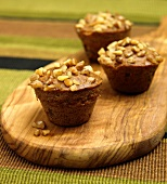 Three Banana Nut Muffins on a Cutting Board