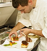 Chef Plating Food in a Restaurant Kitchen