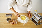 Making Pasta: Beating Eggs in Flour