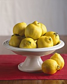 Fresh Quince In and Beside a Pedestal Dish