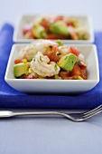 Shrimp Ceviche with Avocado in Small Square White Dishes; Close Up