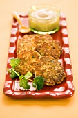 Corn Fritters on a Platter with Parsley Garnish