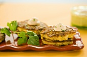 Corn Fritters with Dollops of Cream and Parsley Garnish