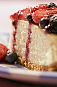 Slice of Cheesecake with Assorted Berry Topping