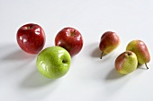 Assorted Apples and Pears on a White Background