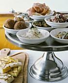Italian Tapas on a Pedestal Dish; Grilled Polenta, Meatballs, Calamari, Sardines