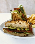BLT with Avocado on Toasted Bread; Halved with French Fries