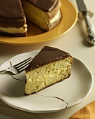 Slice of Boston Cream Pie on a Plate with Fork