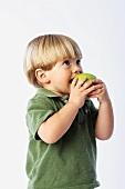 Little Boy Eating a Granny Smith Apple