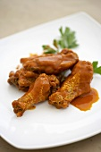 Buffalo Chicken Wings and Drumettes on a White Plate